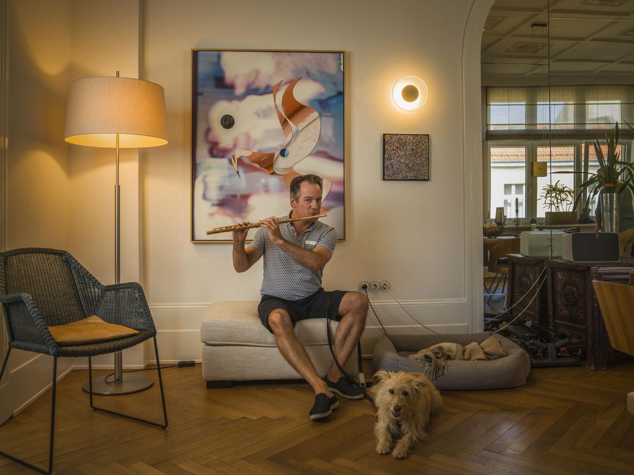 Emmanuel Pahud, principal flutist at the Berlin Philharmonic Orchestra plays his golden flute inside his  Berlin Apartment.
