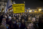 November 16,2015 - Germany, Saxony, Dresden : Demonstrators  hold  placards that read the names of the small Saxon villages they are coming from as they  take part in the demonstration of about 10.000 Supporters of the Pegida movement at their weekly Monday gatherings. Demonstrators shout slogans as: 'Merkel muss weg (Merkel has to go). Pegida is an acronym for 'Patriotische Europaeer Gegen die Islamisierung des Abendlandes,' which translates to 'Patriotic Europeans Against the Islamification of the Occident' and has quickly gained a spreading mass appeal by demanding a more restrictive policy on Germany's acceptance of foreign refugees and asylum seekers. Parts of this  right-wing movement are also against the Euro and the Western liberal style of living in general. The first Pegida march took place in Dresden in October 2014 and has since attracted thousands of participants to its weekly gatherings. But it turned out that even after the Paris attacks last Friday  that left at least more 120 people dead Pegida was not able to attract larger crowds  as in the weeks before the terrorist attacks.