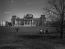 April 17, 2020 - Berlin, Germany: A family relaxes in front of the Reichstag (German Parliament) and  kids do cartwheels during the coronavirus pandemic.  As the rate of new infections nationwide continues to slow, the German government is seeking to establish and implement a roadmap for easing restrictions on public life and the impact  the virus is having on the economy. So far there are over 130,000 cases of confirmed infections of Covid 19 in Germany, over 3,000 people have died and about 57,000 people recovered.