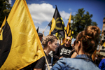 June 17, 2017 - Berlin, Germany: Supporters of the Identitarian Movement shout slogans and wave flags as they march  on Brunnenstrasse in Wedding district.  The Identitarian Movement originated in France and with its ideology of a racially-based concept of European identity has drawn right-wing supporters across Europe. The movement has positioned itself against the acceptance of Muslims and Islam in Europe and has also sought to stop immigration from non-European nations.