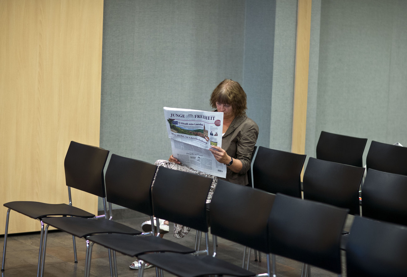 July 18, 2013 - Berlin, Berlin, Germany: A woman reads the German nation wide weekly 'Junge Freiheit', main headline today  is about the  Alsace region in France. The Junge Freiheit (JF, Young Freedom) is a German weekly newspaper for politics and culture, that describes itself as liberal-conservative. The JF has been described as the central publication of the Neue Rechte (New Right) . Supporters of the German Euro critical AfD Party (Alternative fuer Deutschland) gather for the speech of  Prof. Joachim Starbatty, author of the anti Euro book:  'Tatort Euro' (crime scene Euro). Mr. Starbatty is a retired economist and former member of chancellor Merkels CDU party. The AfD party launches it's campaign in Berlin with this event, general elections in Germany are scheduled for Sept. 22.. Hermann Bredehorst/Polaris )