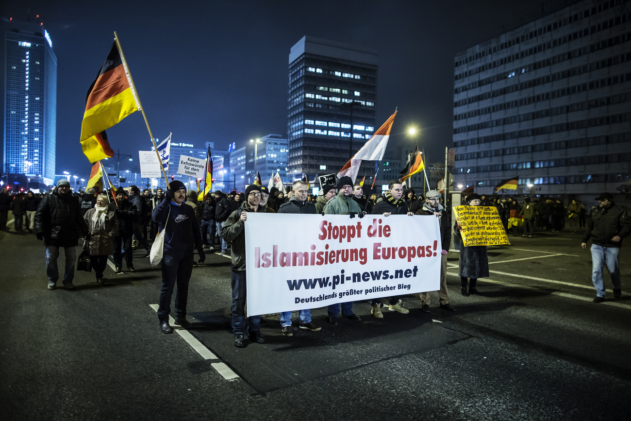 January 19, 2015 -Germany,  Berlin, Berlin: Protesters hold a placard that reads: 'Stop the Islamization of Europe' at an Anti-Islam protesters march during a BERGIDA rally, a local copycat of Dresden's right-wing populist movement PEGIDA (Patriotic Europeans Against the Islamisation of the Occident), at Alexander Platz in Berlin, eastern Germany. The planned  Dresden demonstration rally by the anti-Islamic Pegida movement  was banned by German police with other public open-air gatherings in the eastern city of Dresden on Monday, citing a terrorist threat.