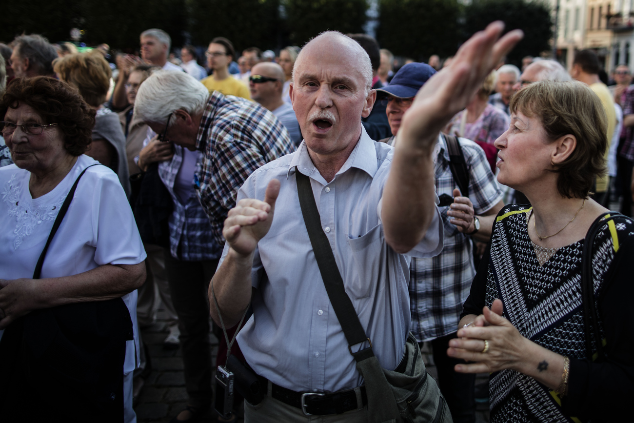 August 19, 2016 -Schwerin, Germany: Angry supporters threaten journalists as they  applaud and shout: 'Hoecke, Hoecke' while  they listen to Bjoern Hoecke, head of the Alternative fuer Deutschland political party (Alternative for Germany, AfD) in Thuringia and Holm, lead candidate for the AfD in Mecklenburg Western Pomerania. Both agitate a small crowd at an AfD party rally. The anti-immigration party is surging after Germany took in most of the more than 1 million refugees who arrived in the European Union last year. The party's rise is narrowing coalition-building options for Germany's established parties and threatens the status quo nationwide. Polls suggest the AfD will win up to 19% of the votes in this east German state of Mecklenburg-Western Pomerania, where Germanys Chancellor Merkel has her electoral district.