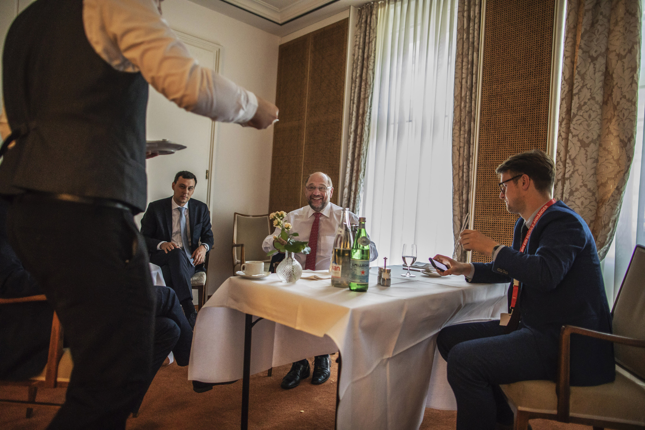 September 21, 2017 - Hannover, Germany:    Social Democrats Party (SPD) leader and candidate for Chancellor Martin Schulz takes a break inside a hotel before he greets fans and speaks to supporters  at an election campaign rally of the SPD in the Northern  town of Hannover, during the final days before Germans head to the polls. At right sits the speech writer of Mr. Schulz, Jonas Hirschnitz. Onleft site sits Julian Lange. deputy speaker of Mr. Schulz. (Hermann Bredehorst / Der Spiegel / Polaris)