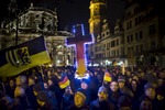 December 22, 2014 -Germany,  Saxony, Dresden :  A demonstrator holds a illuminated cross as he takes part in the demonstration of about 17500 Supporters of the Pegida movement  at another of their weekly gatherings. Demonstrators shout slogans as: 'Luegenpresse' (Mendacious Press) and 'Wir sind das Volk (We are the people' the 1989 slogan of the GDR's peacefull freedom demonstrations). 'Pegida is an acronym for 'Patriotische Europaeer Gegen die Islamisierung des Abendlandes,' which translates to 'Patriotic Europeans Against the Islamification of the Occident' and has quickly gained a spreading mass appeal by demanding a more restrictive policy on Germany's acceptance of foreign refugees and asylum seekers. Parts of this  right-wing movement is also against the Euro and the Western liberal style of living in general. The first Pegida march took place in Dresden in October and has since attracted thousands of participants to its weekly gatherings that have also begun spreading to other cities in Germany. (Hermann BredehorstPolaris)
