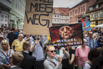 August 26, 2017 - Quedlinburg: Protestors of the Neo Nazi and right wing political  spectrum like the AfD, NPD and the Identitarian movement protest during German Chancellor and Christian Democrat (CDU) Angela Merkels speech  at an election campaign stop in Quedlinburg, Germany. Merkel is seeking a fourth term in federal elections scheduled for September 24 and she currently holds a double-digit lead over her main rival, German Social Democrat Martin Schulz.(Hermann Bredehorst / Der Spiegel / Polaris)