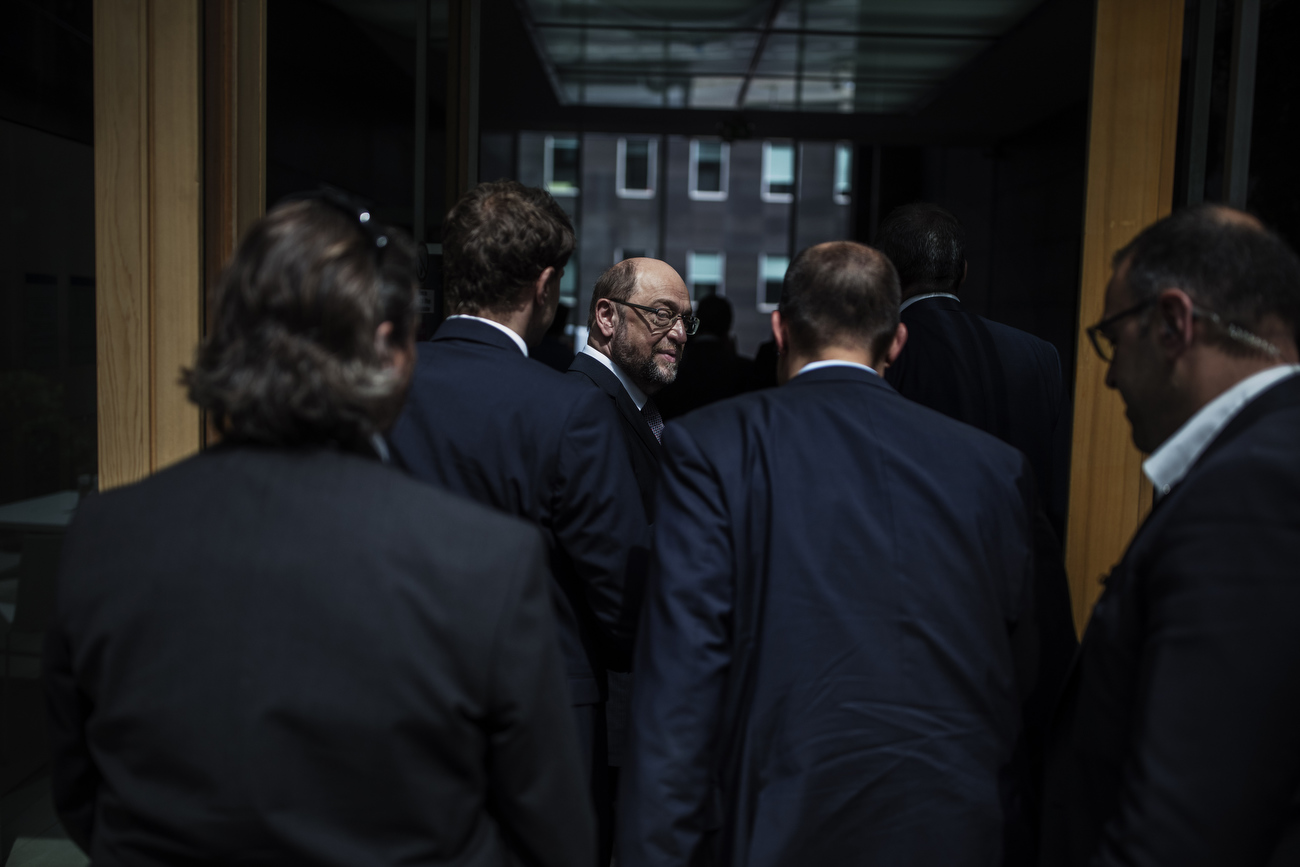 June 27, 2017 - Berlin, Germany: Martin Schulz, leader of Germany's social democratic SPD party (C) and candidate for Chancellor looks back over his shoulder as he leaves the building surrounded by his speaker, aides and members of his security detail after speaking at a press conference to sum up the Social Democrats coalition with Merkels CDU/CSU party before the end of this parliamentary term. Schulz and leading members of his party presented the SPD's accomplishments as a member of the current German coalition government but also listed its many policy shortcomings that it blames on its coalition partner. Germany faces federal elections in September. Schulz tweeted:  {quote}We will push through marriage equality in Germany,{quote}  {quote}This week.{quote} . (Hermann Bredehorst / Polaris)