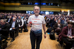 April 30, 2016 - Germany, Stuttgart: A man wears a t-shirt that reads: Democracy instead of Merkulatur as he joins about 2000 registered members that attend the party congress of the right-wing party Alternative für Deutschland (AfD). The rapidly growing party is expected to adopt an anti-Islamic manifesto, emboldened by the rise of other European anti-migrant groups like Austria's Freedom party.