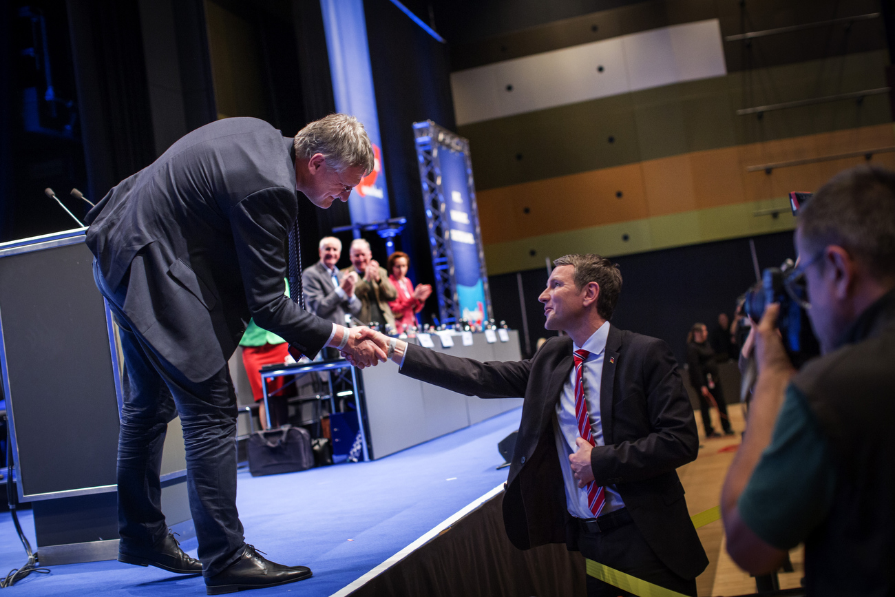 April 30, 2016 - Germany, Stuttgart: Bjoern Hoecke (R), AfD leader of the state of Thuringia shakes hands  with AfD co party leader Joerg Meuthen at the party congress of the right-wing Alternative für Deutschland (AfD). This marks a historic moment as the next step to drift even more to the right for the party. The rapidly growing party is expected to adopt an anti-Islamic manifesto, emboldened by the rise of other European anti-migrant groups like Austria's Freedom party. (Hermann Bredehorst/Polaris)