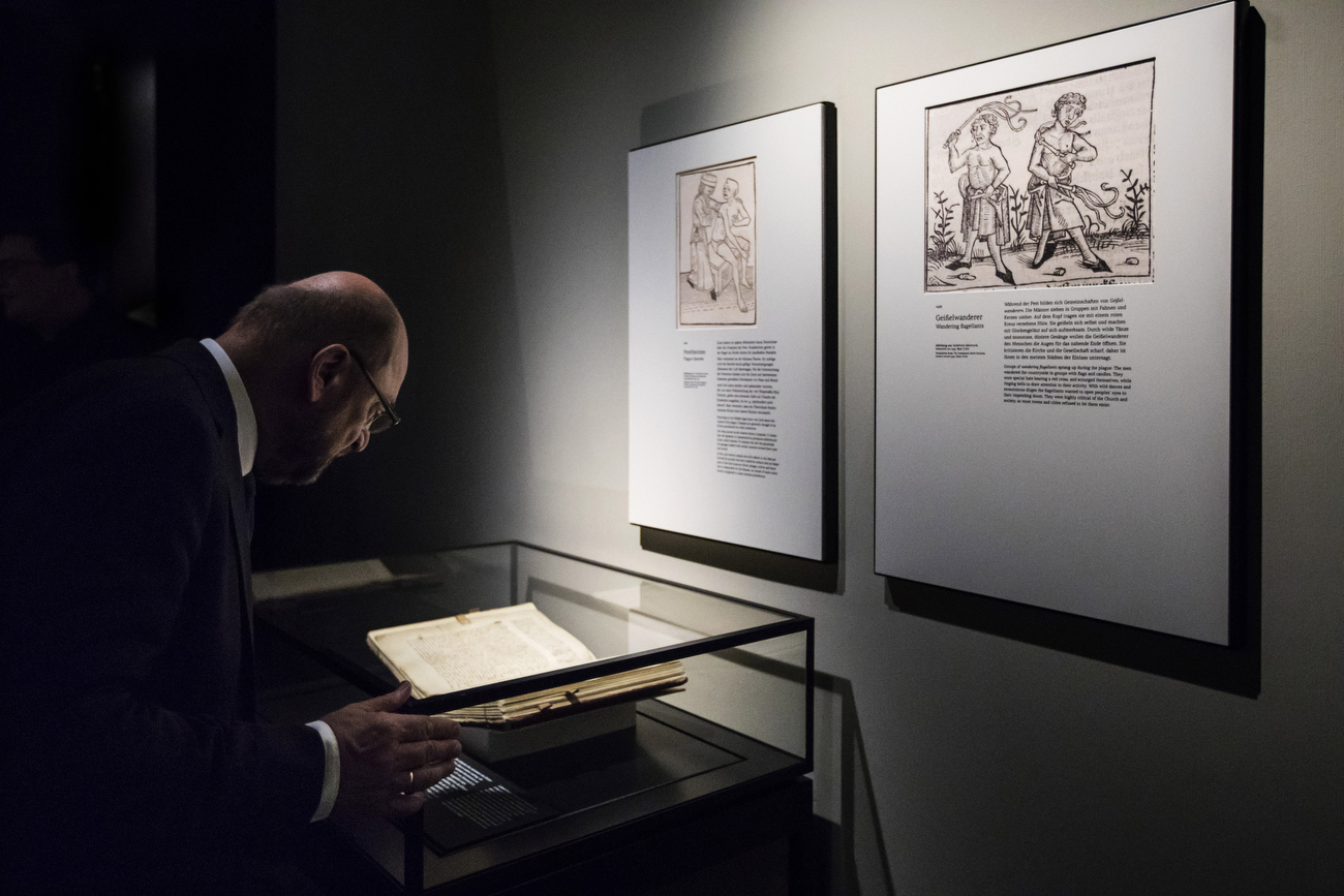 August 31, 2017 - Luebeck: SPD chancellor candidate and party leader and former book store owner, Martin Schulz takes his time to read in a an old book which is on display at a section of the Hansemuseum during a campaign stop to visit to the  European Hansemuseum. (Hermann Bredehorst / Der Spiegel / Polaris)