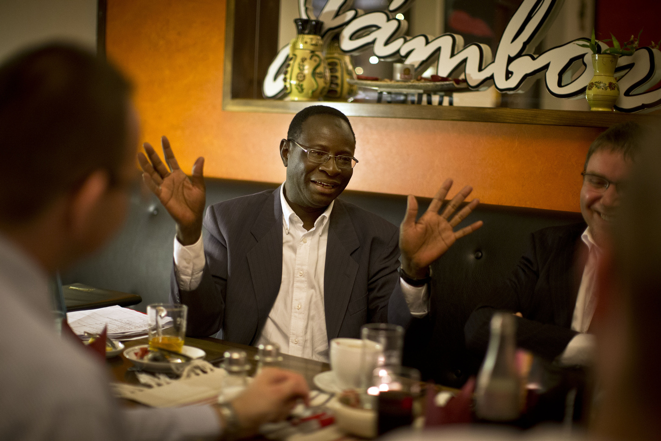 Senegalese born Karambe Diaby , Social Democratic candidate for the German Parliament gestures as he attends the :gay regular's table{quote} in his constituency in Halle/Saale. Diaby, a PhD in chemistry, canvassed the former hub for East Germany's chemical industry to become the first black member of the Bundestag in German history.