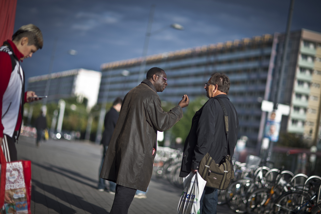 Senegalese born Karambe Diaby , Social Democratic candidate for the German Parliament gestures as he talks to a citizen while on the campaign trail in his constituency in Halle/Saale. Diaby, a PhD in chemistry, canvassed the former hub for East Germany's chemical industry to become the first black member of the Bundestag in German history.