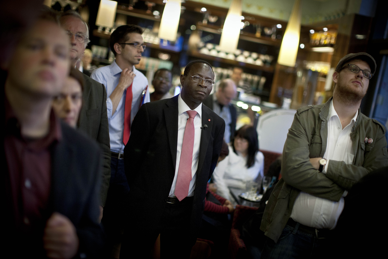 Senegalese born Karambe Diaby , Social Democratic candidate for the German Parliament reacts after he first projections on election day in his constituency in Halle/Saale. Diaby, a PhD in chemistry, canvassed the former hub for East Germany's chemical industry to become the first black member of the Bundestag in German history. Although Karamba failed to secure a direct mandate from his district, he managed to get elected through Germans' second votes, which are cast for so-called party lists.