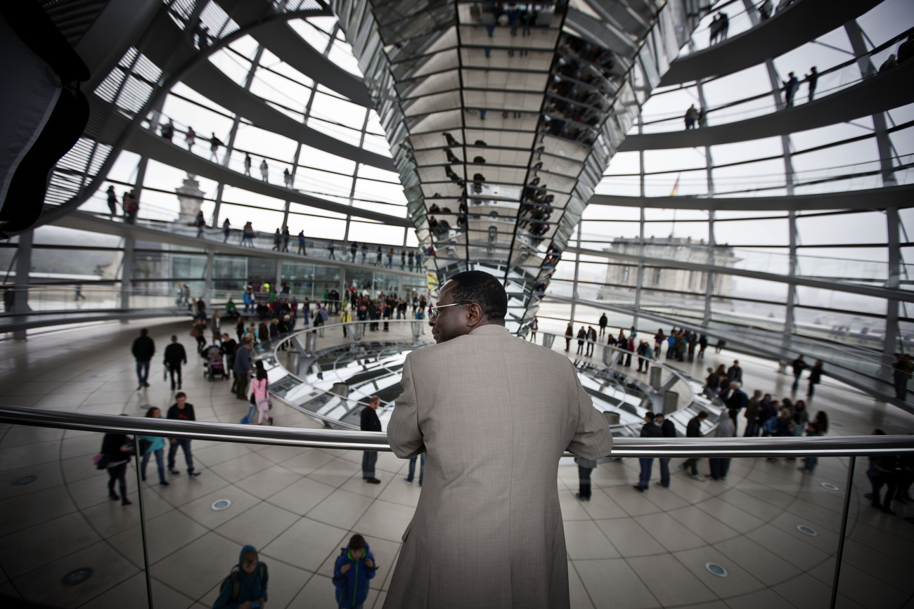 Newly elected member of the German Parliament {quote}Bundestag {quote} Karambe Diaby visits the cupola of the Reichstag as he attends his first parliamentary session of the Social Democratic party's fraction in Berlin. Senegalese born Diaby, a PhD in chemistry, canvassed Haale, Saale, the former hub for East Germany's chemical industry to become the first black member of the Bundestag in German history.