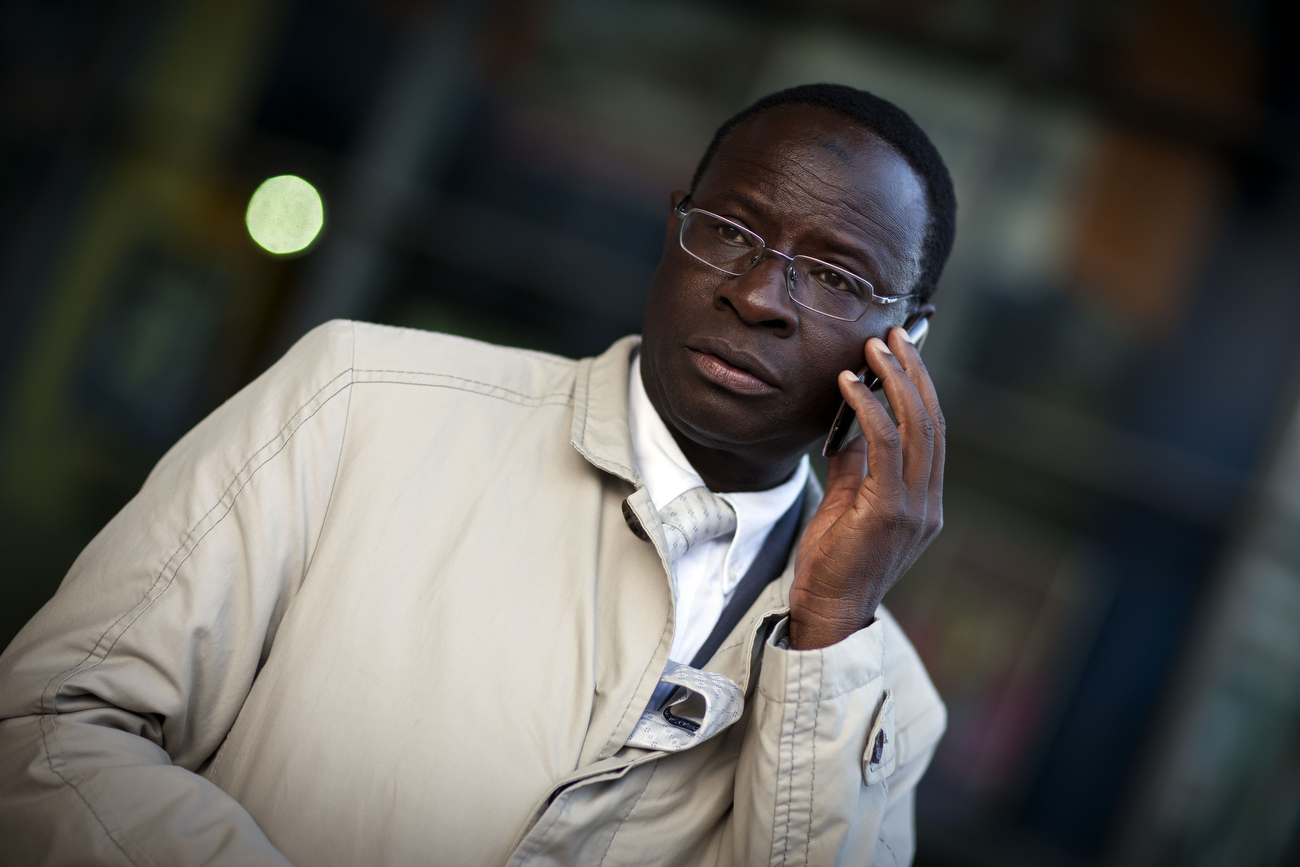 Senegalese born Karambe Diaby , Social Democratic candidate for the German Parliament talks to his aides on the phone while on the campaign trail in his constituency in Halle/Saale. Diaby, a PhD in chemistry, canvassed the former hub for East Germany's chemical industry to become the first black member of the Bundestag in German history.