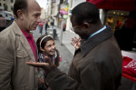 A young girl and her father react as they chat with Senegalese born Karambe Diaby , Social Democratic candidate for the German Parliament, while on the campaign trail in his constituency in Halle/Saale. Diaby, a PhD in chemistry, canvassed the former hub for East Germany's chemical industry to become the first black member of the Bundestag in German history.