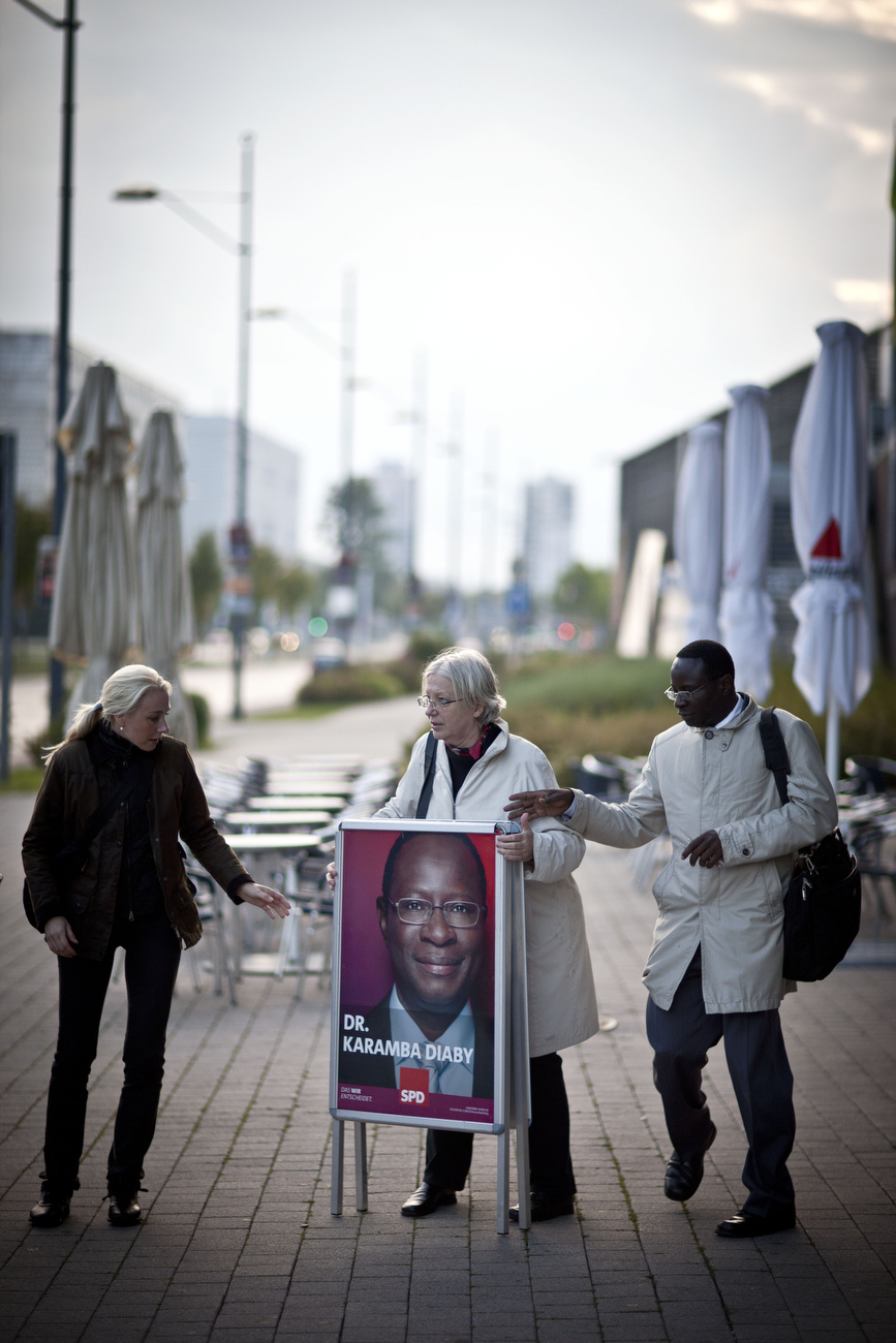 Senegalese born Karambe Diaby , Social Democratic candidate for the German Parliament and aides set up a campaign poster in his constituency in Halle/Saale. Diaby, a PhD in chemistry, canvassed the former hub for East Germany's chemical industry to become the first black member of the Bundestag in German history.