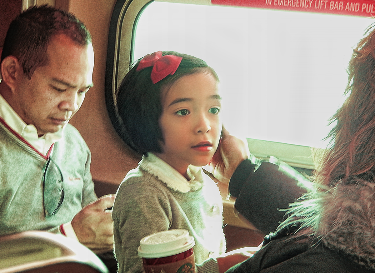 girl_on_train_with_dad1200