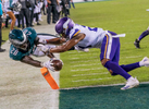 PHILADELPHIA, PA - OCTOBER 07: Running back Wendell Smallwood #28 of the Philadelphia Eagles scores a two-point conversion against cornerback Mike Hughes #21 of the Minnesota Vikings during the fourth quarter at Lincoln Financial Field on October 7, 2018 in Philadelphia, Pennsylvania