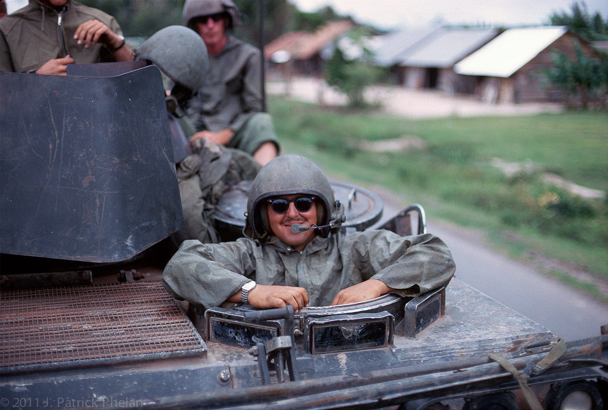 M113 APC driver Ronald Belford with his rain gear on smiles for the camera. Ron was from Genesee, Michigan, and passed away April 9, 1997. See you at Fiddler's Green Ron!