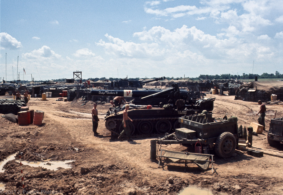 A 3rd fo the 13th Field Artillary M110 8{quote} self propelled howitzer, with ammo trailer in the foreground, at Fire Support Base Hampton located at the southeast edge of GoDau Ha, South Vietnam, is being made ready to be moved.