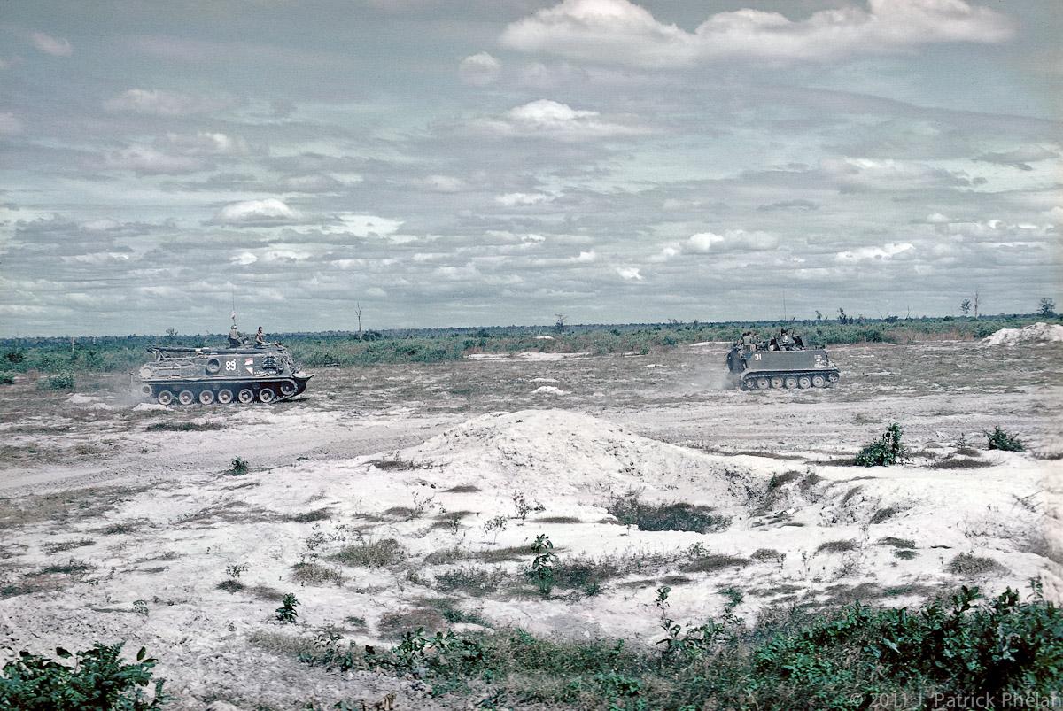 An M88 VTR follows an M113 to retrieve an M48A3 tank that hit a mine and lost a track.