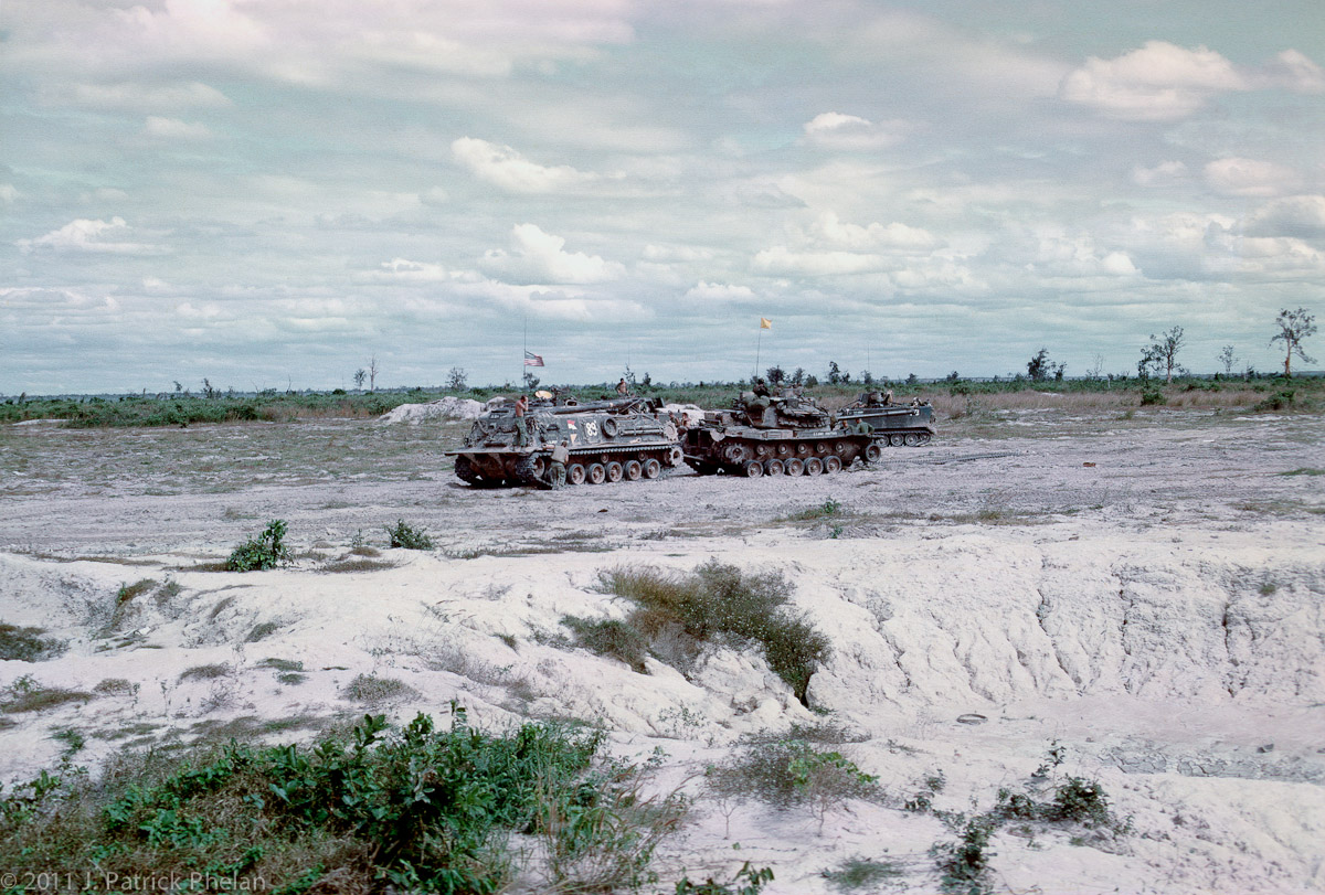 An M88 is prepairing to tow a damaged M48A3 that hit a mine and lost a track.