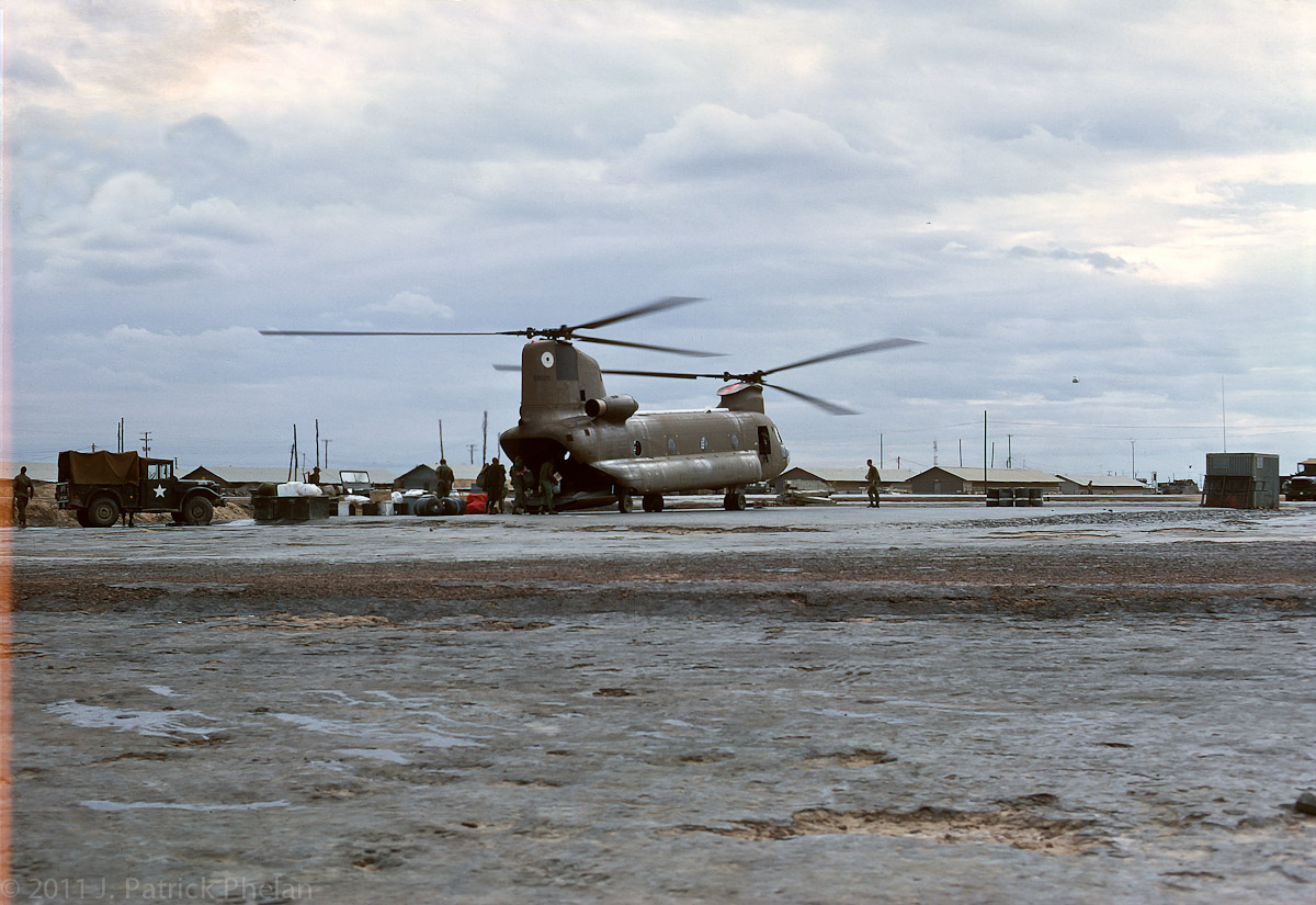 A Chinook helicopter is being loaded with supplies in Cu Chi to be flown to the field.