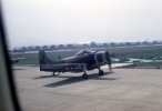 Bien Hoa Air Base with VNAF T-28 Trojan bombers waiting to taxi.