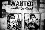 A graffiti showing a portrait of Mohamed El Shenawy, a police officer who was accused of shooting at the protesters targeting the eyes. He was named the eyes hunter. {quote}Wanted by the Egyptians{quote} written above his picture.