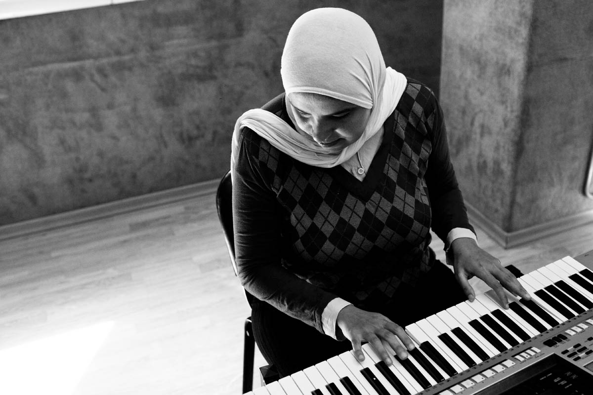 Heba plays the piano and sings in a choir at {quote}Banat AL Noor{quote} Association, Heba has a beautiful strong voice