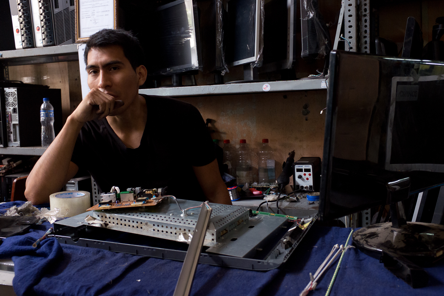 """I got my degree in graphic design, but started repairing LCDs about three years ago,"" said Richard, who opened his own shop on Leticia one year ago."