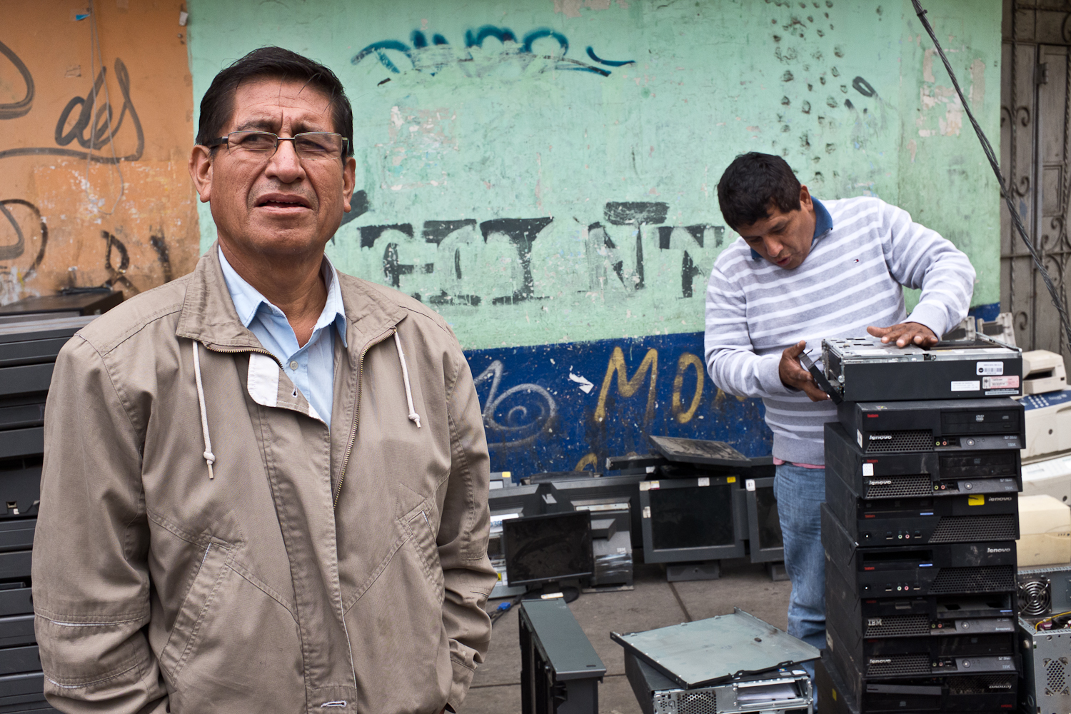 Senor Freddy (left) has been selling used electronics on Leticia street for nearly a decade. When asked why collectors and resellers such as himself don't organize to establish a government-recognized union of informal collectors/refurbishers, he shrugged. {quote}It's too difficult to organize the other collectors.{quote} Other collectors and refurbishers noted that formalizing the informal sector would increase their costs, especially for disposing components such as CRTs that no longer have market value but contain hazardous materials that require safe handling. Other countries such as Brazil and India have formalized informal collectors and waste pickers into unions, thus providing the opportunity to engage more directly with other stakeholders in the formal sector.Nonetheless, another refurbished CRT TV vendor, Daniel Rodriguez (not shown) lamented, {quote}I wish the NGOs and government officials would recognize our importance in keeping these productsout of the environment by extending their use. But they don't want to work with us.{quote}