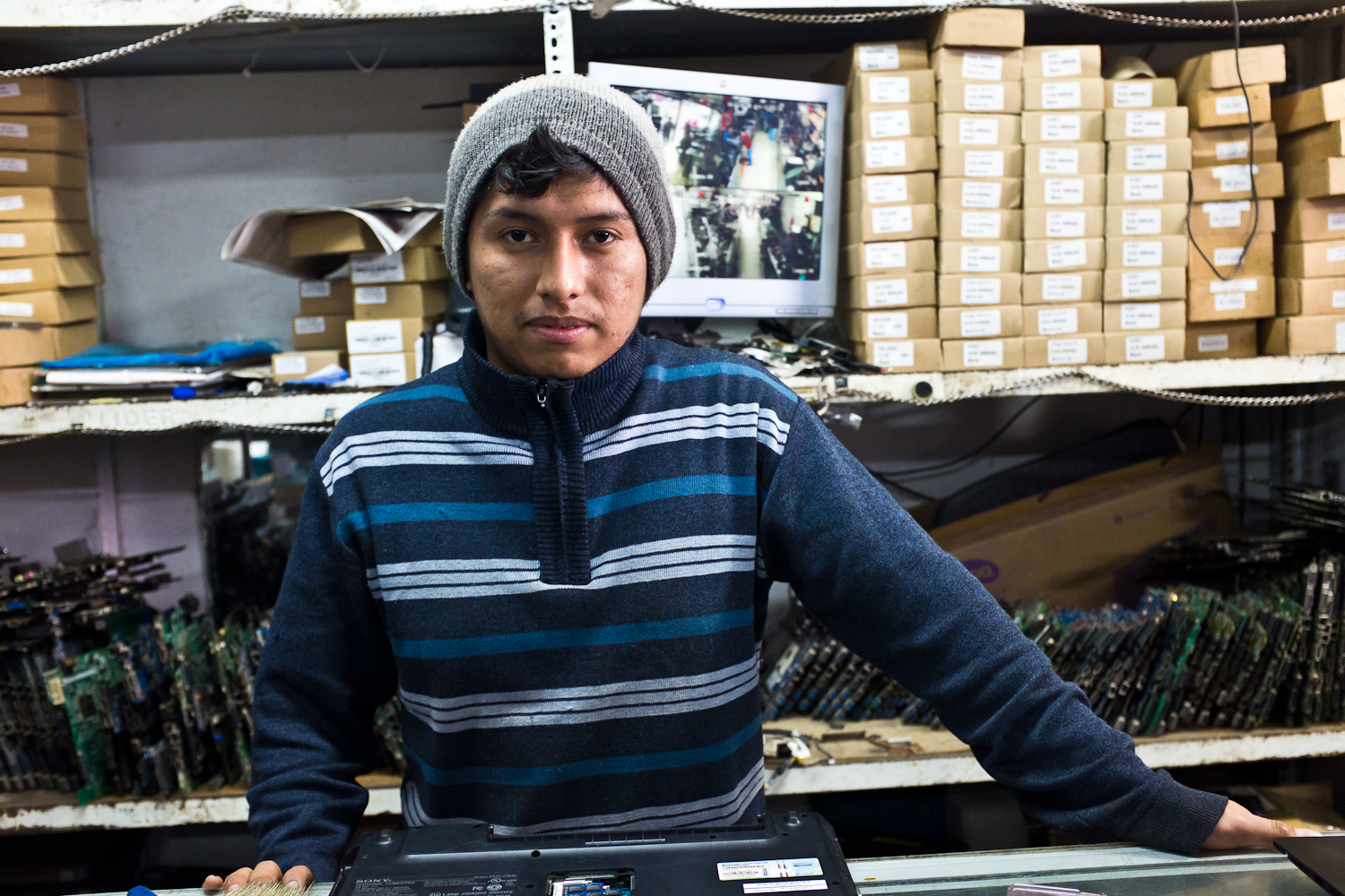 "Aldair, a computer repair technician. ""I used to work in a wool factory, six days a week,"" he recounted. ""Sometimes I would work nights only for two week stretches and then have to shift back. It wasn't great."" His hours are now 9-5, 5 days a week. How did he learn to repair laptops? ""I took one course. But after that, You Tube [has been] a great teacher.{quote}"