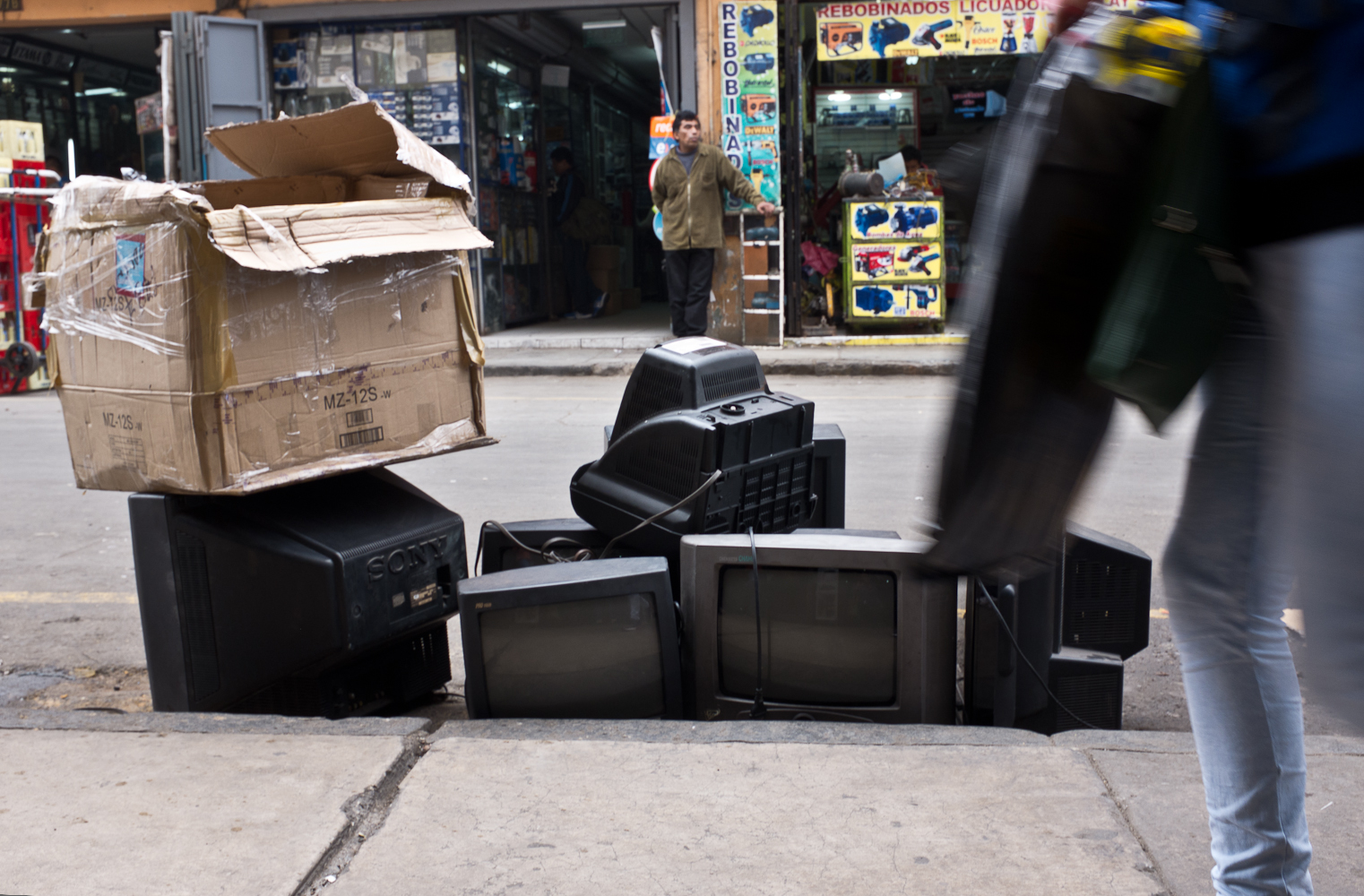 Cathode Ray Tube (CRT) televisions being prepared for repair and resale, just off Leticia street in central Lima.