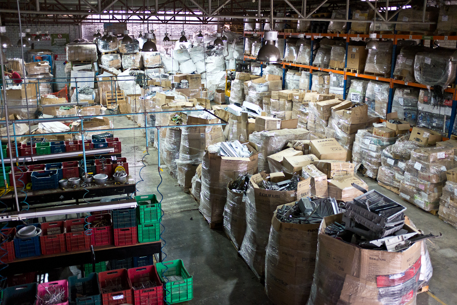 Extended Producer Responsibility legislation in Peru, where manufacturers pay into a recycling system to ensure that products are safely recycled, has given rise to an emerging formal electronics recycling sector. At Peru Green's recycling facility, products are dismantled at workstations (left) and materials are sorted into giant bins. A small percentage of components are sold to a local metals processor. The majority of components, such as printed circuit boards and copper cables, are shipped to either the U.S., Europe or China for further processing since Peru Green does not currently have a mechanism for further reducing or shredding components down to their commodity, or raw material, level. Peru Green's recycling contracts with institutions prohibit reuse, thus incentivizing exports of components to regions where they have high market value. In Peru, a less industrialized country, formal recyclers have limited options for processing components beyond dismantling them, highlighting the need to shore up transparency and certification schemes for recyclers across all industrialized and non-industrialized markets.