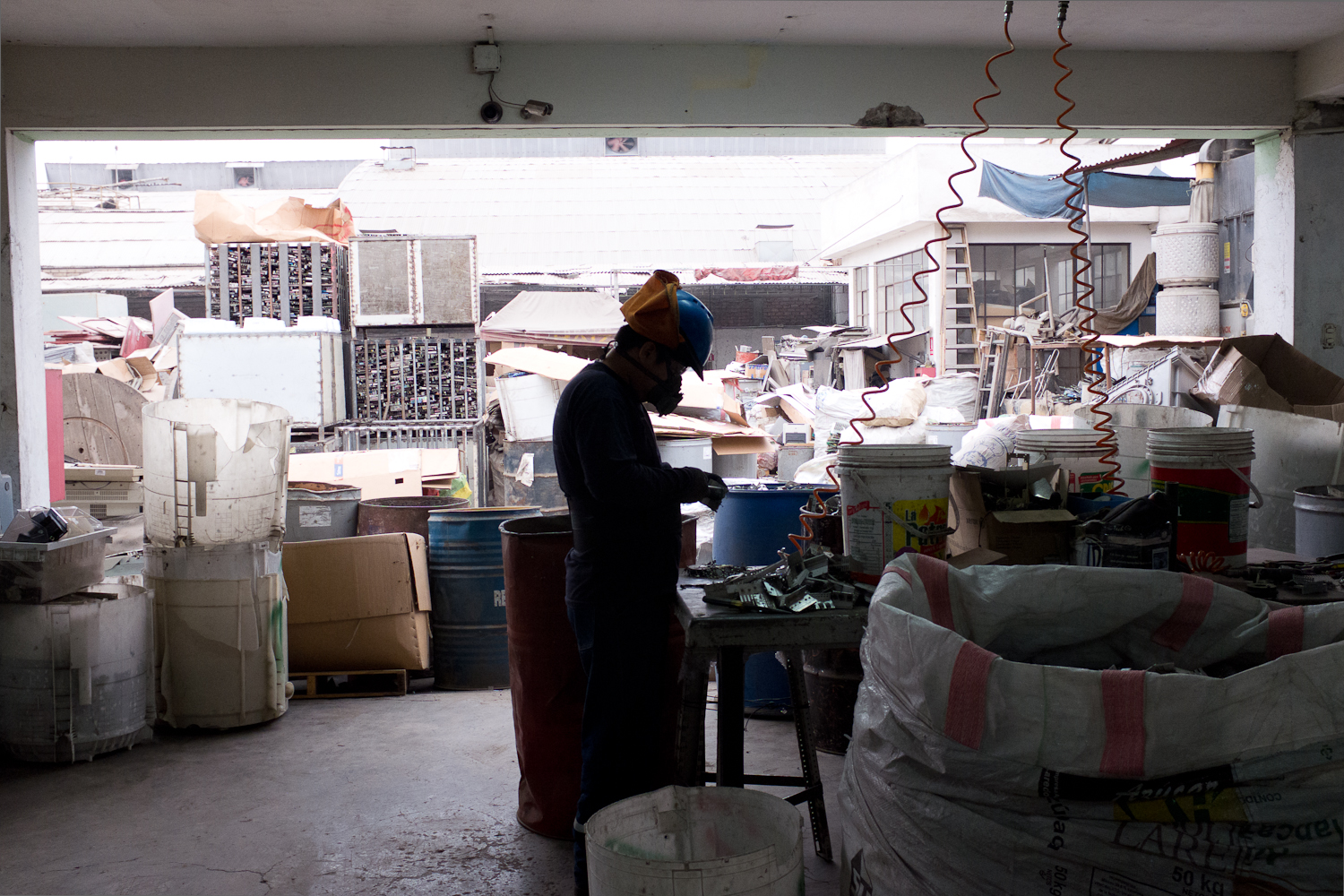 A worker dismantles electronic products under safe conditions. Under its contractual obligations with commercial customers, this formal recycling facilty does not refurbish electronics or salvage parts for reuse. While some metals are sold to local markets, components such as circuit boards, copper cables, and plastics are baled and prepared for export for further processing.The emergence of the formal sector potentially gives rise to competition with the informal sector for the same materials. Understanding the relative strengths of both entities and the benefits they both bring to society is important to allow for different forms of employment to flourish. In addition, pinpointing where vulnerablities exist in safely recycling these products-- such as informal CRT glass disposal-- and recognizing the socio-political dynamics that limit collaboration between the formal and informal sectors is critical for forging a system where both can thrive. Finally, given technological constraints among Peru's formal recyclers, stakeholders should look to shore up certification of best recycling practices in key regions, such as Asia and the United States, so that all countries who must export material have access to sound end-of-life processing methods that are transparent for all, or build up local recycling capacities through technology transfers.