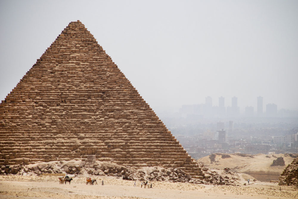 Pyramid at Giza. Cairo hovers in the near distance.