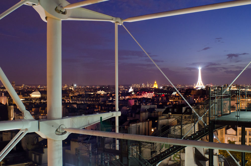 A view from the roofdeck of the Centre Pompidou in Paris. Once night falls, the Eiffel Tower erupts at the stroke of every hour with sparkling glee.