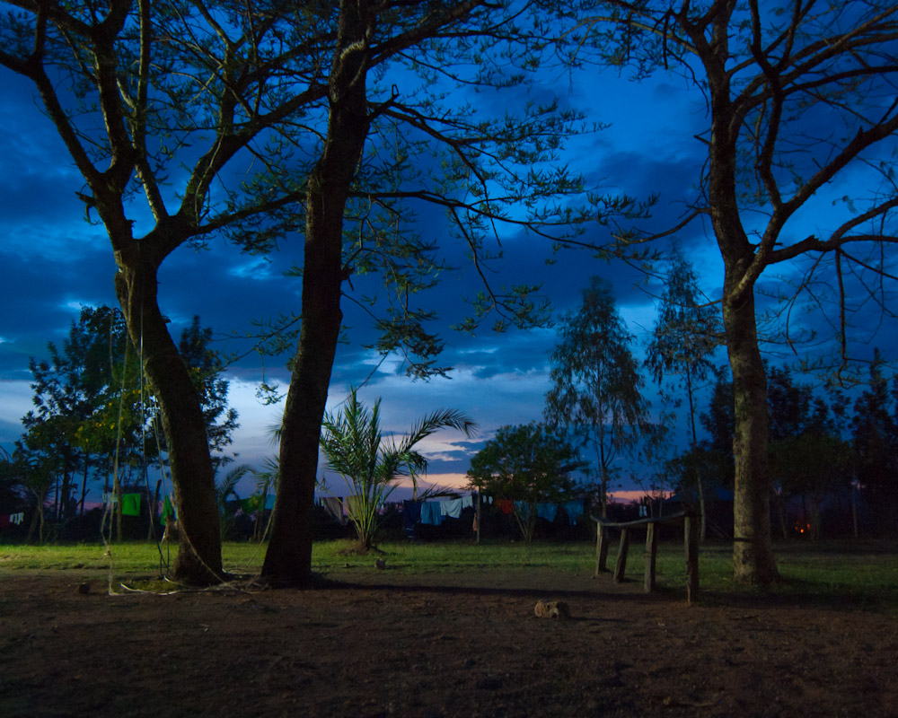 Dusk, St. Luke's premises in Miwani, rural Western Kenya.{quote}In life it is easy to always welcome in but it is much harder to welcome out. Now you are family, so there is a hole that is created when you leave. It hurts when you let go of family, so don't let go of us.{quote} - Gordon, age 22, STARS graduate.