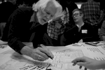 Community members pore over and provide input to Southwest's development plans at a public meeting.