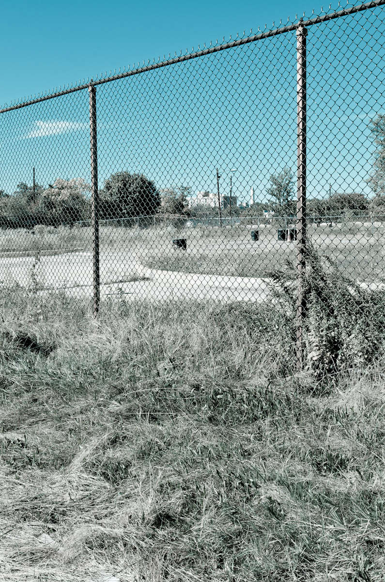 The site near Buzzard Point,slated for development of the soccer stadium. The site, an industrial zone is located next to a cement factory, a former scrap recycling yard, and power substation as well as two blocks from a low-rise low-income housing. Local residents have expressed concern over the potential for soil and air contaminants to impact the community once new construction begins.