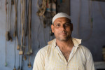Mohammed Javd owns a repair shop in the Seelampur district of New Delhi. The slum is one of India's most concentrated centers of informal processing, containing an estimated 25,000 workers.