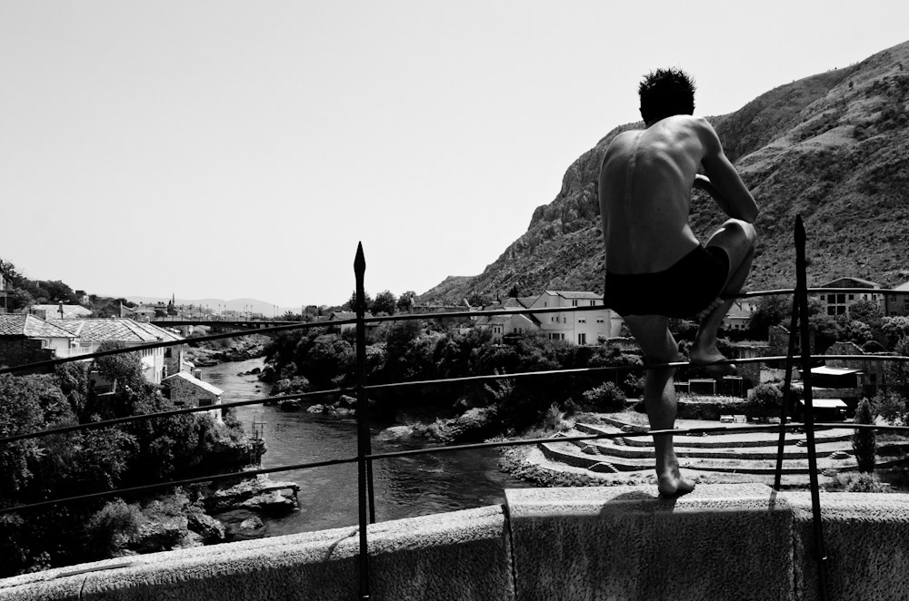 Day trip to Mostar, visiting the famous bridge that was destroyed and then rebuilt after the most recent Bosnian War. Young men wait on the bridge in their swimtrunks for tourists to pay them to jump into the river below. Once they amass a certain amount of Euros, they leap from the railing.