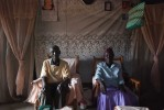 Pastor Awino and his wife, elders within the St. Luke's community, at their home. Most villagers in Miwani live in simple mud-walled homes with two rooms without amenities or electricy.