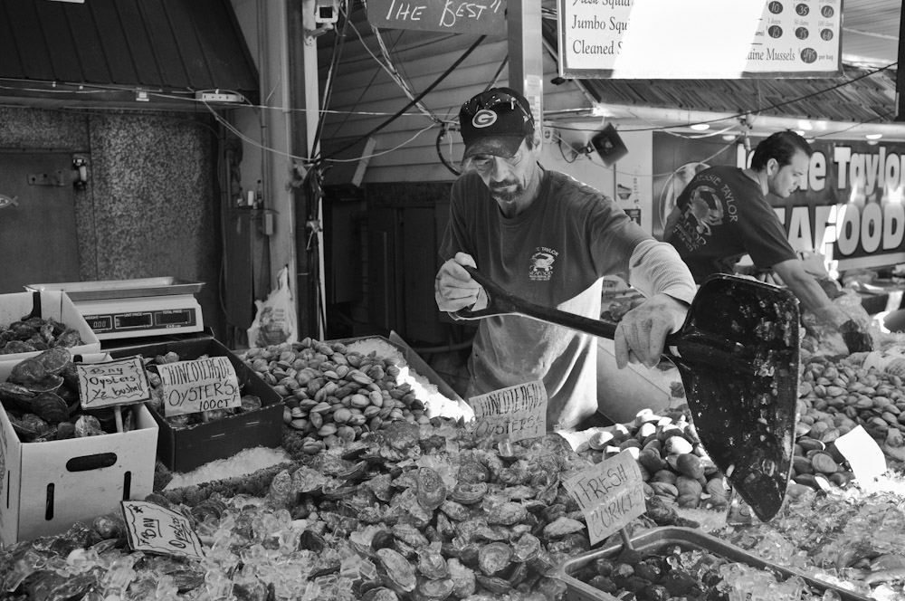 The Fish Market in Washington DC, down by the SW waterfront has been a mainstay in the city for decades. Soon, it is slated to undergo significant renovations. On a typical Saturday morning at the market, fishmongers who have worked there for decades, such as Patrick (pictured here), prepare for their first customers.
