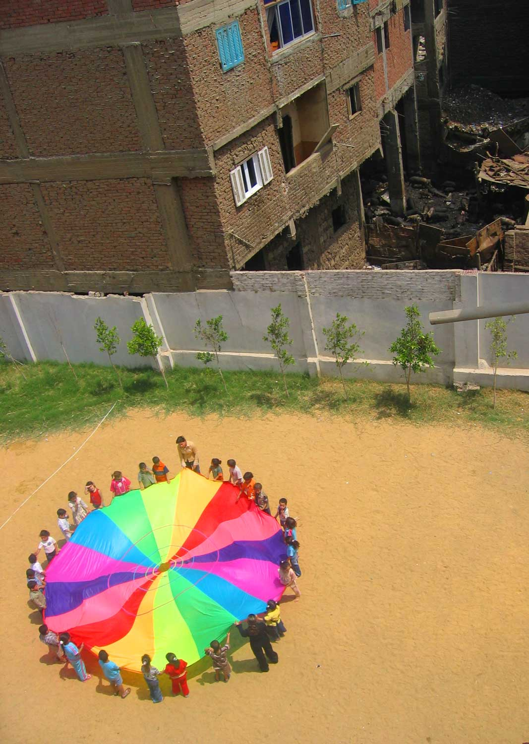 Children play in the courtyard of an elementary school located in the midst of one of Cairo's largest slums.