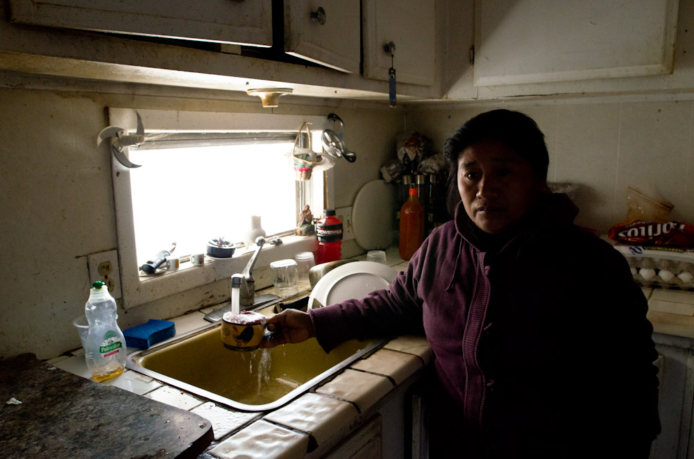 Valeriana, a local community organizer in her home in Tooleyville, where the drinking water is not safe for human consumption.