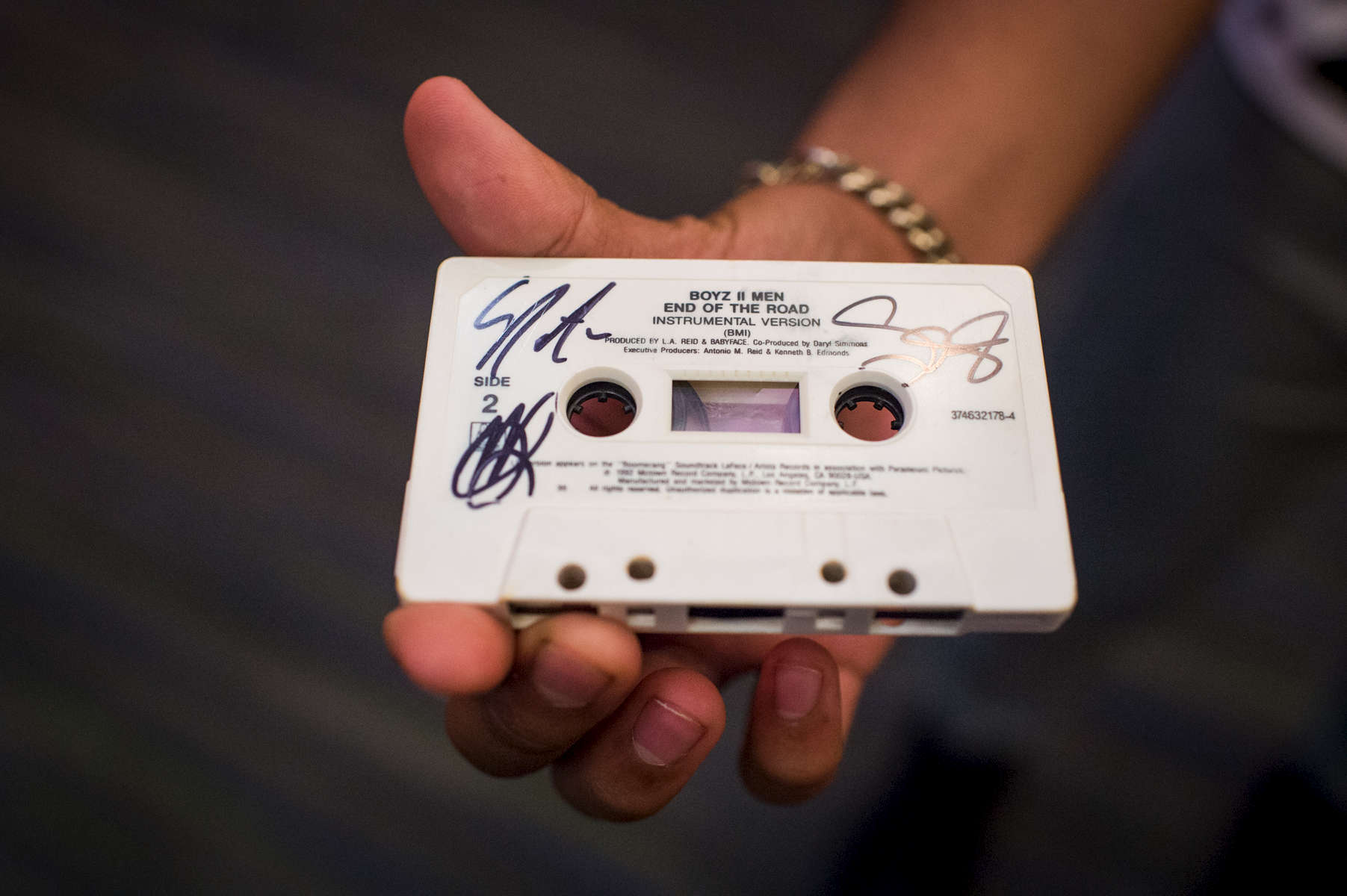 "At the Guam Premiere Outlets in Tamuning, Guam, a young Boyz II Men fan asks the band members to sign his cassette tape of their song, ""End of the Road."" (Dec. 14, 2017)Photo by Nancy Borowick"