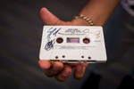 """At the Guam Premiere Outlets in Tamuning, Guam, a young Boyz II Men fan asks the band members to sign his cassette tape of their song, """"End of the Road."""" (Dec. 14, 2017)Photo by Nancy Borowick"""